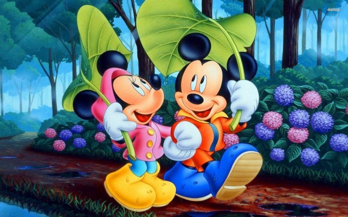 Imágen de amor de Minnie y Mickey paseando en el parque tomados de la mano