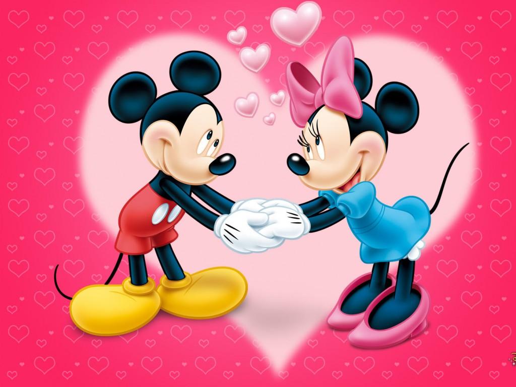 Imágen de amor de Minnie y Mickey tomados de la mano con un corazón de fondo